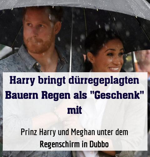 Prinz Harry und Meghan unter dem Regenschirm in Dubbo