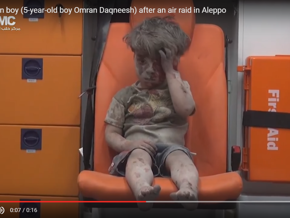Bloody Syrian boy (5-year-old boy Omran Daqneesh) after an air raid in Aleppo