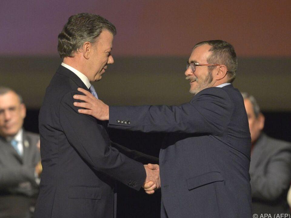 Präsident Santos und FARC-Führer Jimenez