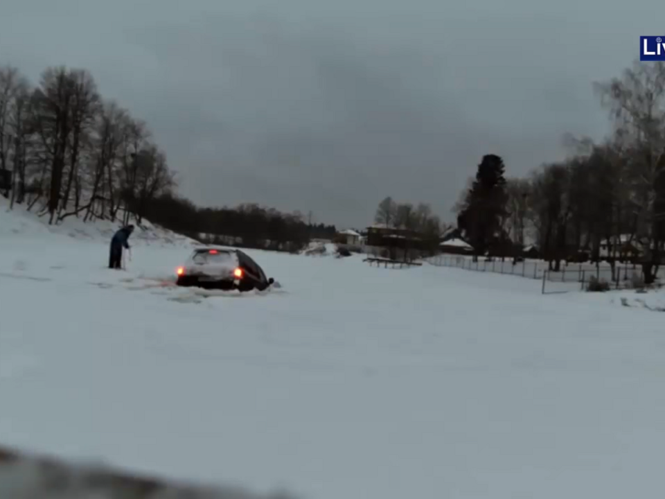 YouTube/Live Leak-Toyota Land Cruiser falls in ice after drifting
