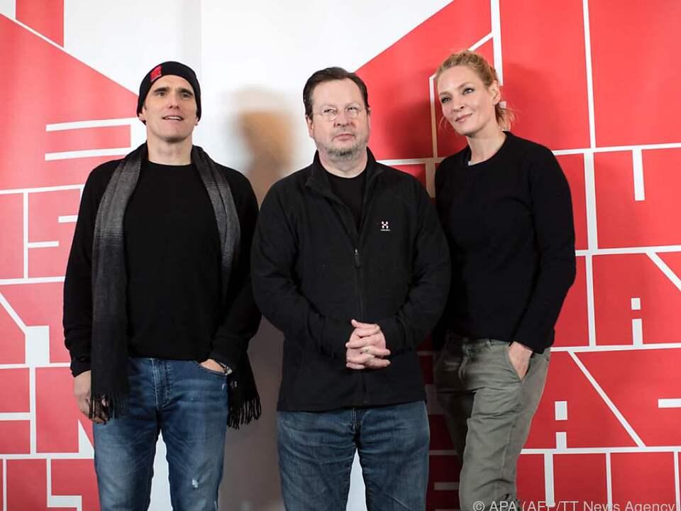 Von Trier (m.) lässt Matt Dillon (l.) serienmorden