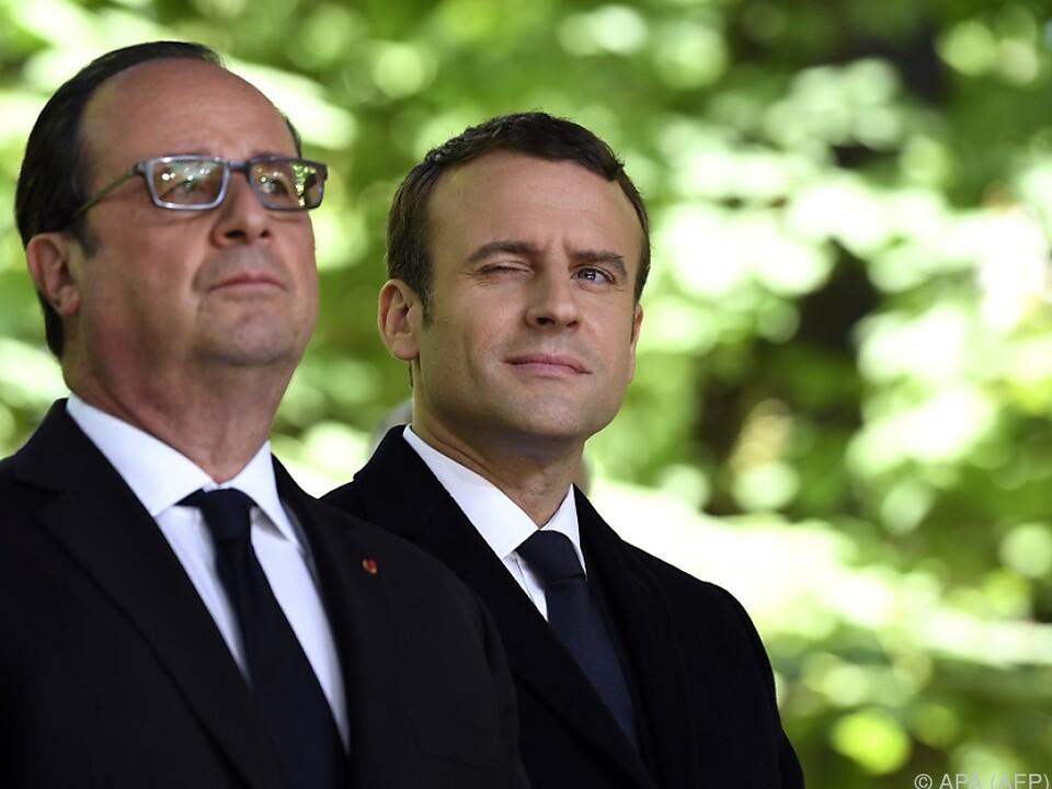 Hollande (l.) setzt seine Hoffnung auf den jungen Politiker