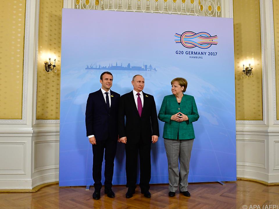 Treffen von Macron, Putin und Merkel