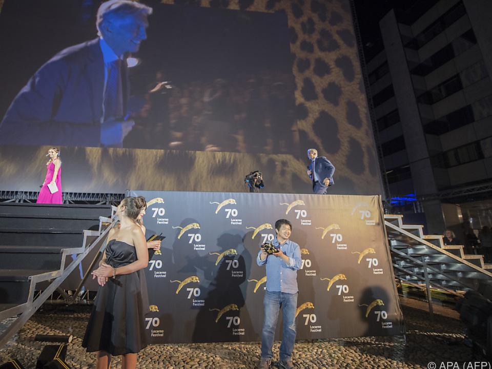 Wang Bing mit seinem Leoparden