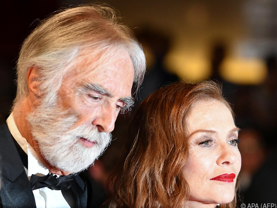Haneke mit seiner Hauptdarstellerin Isabelle Huppert