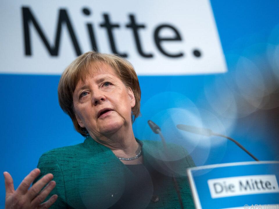Merkel holt sich Kritiker ins Kabinett