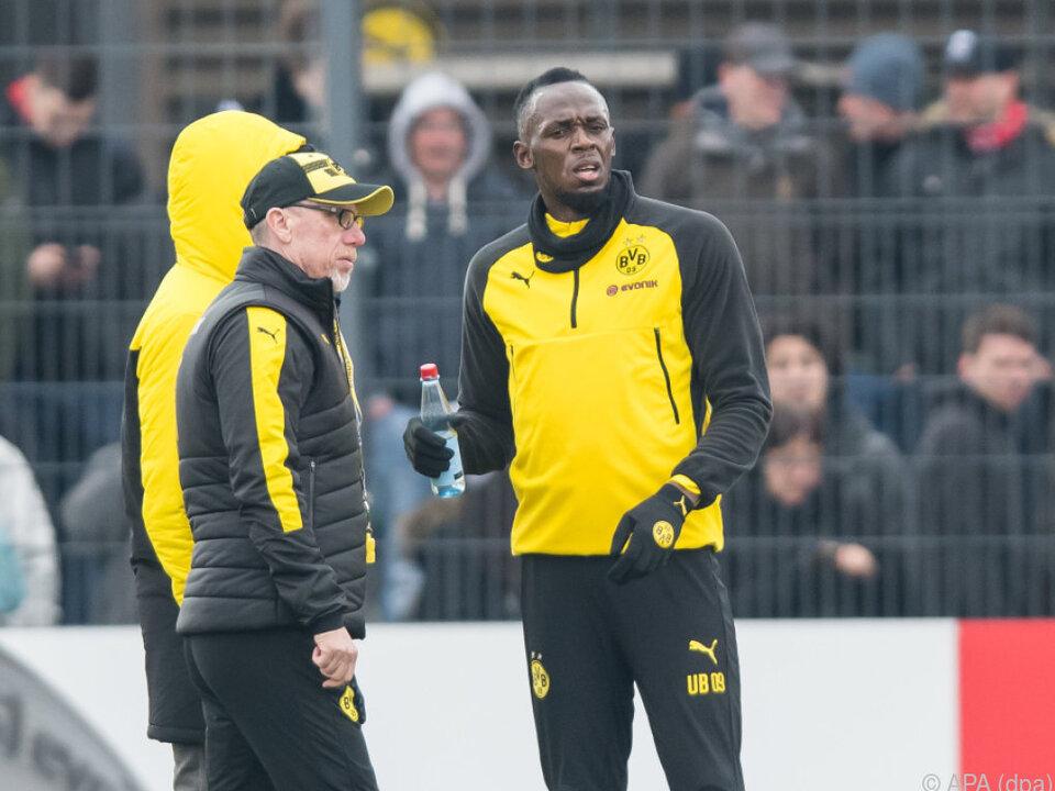 Bolt mit Dortmund-Trainer Peter Stöger