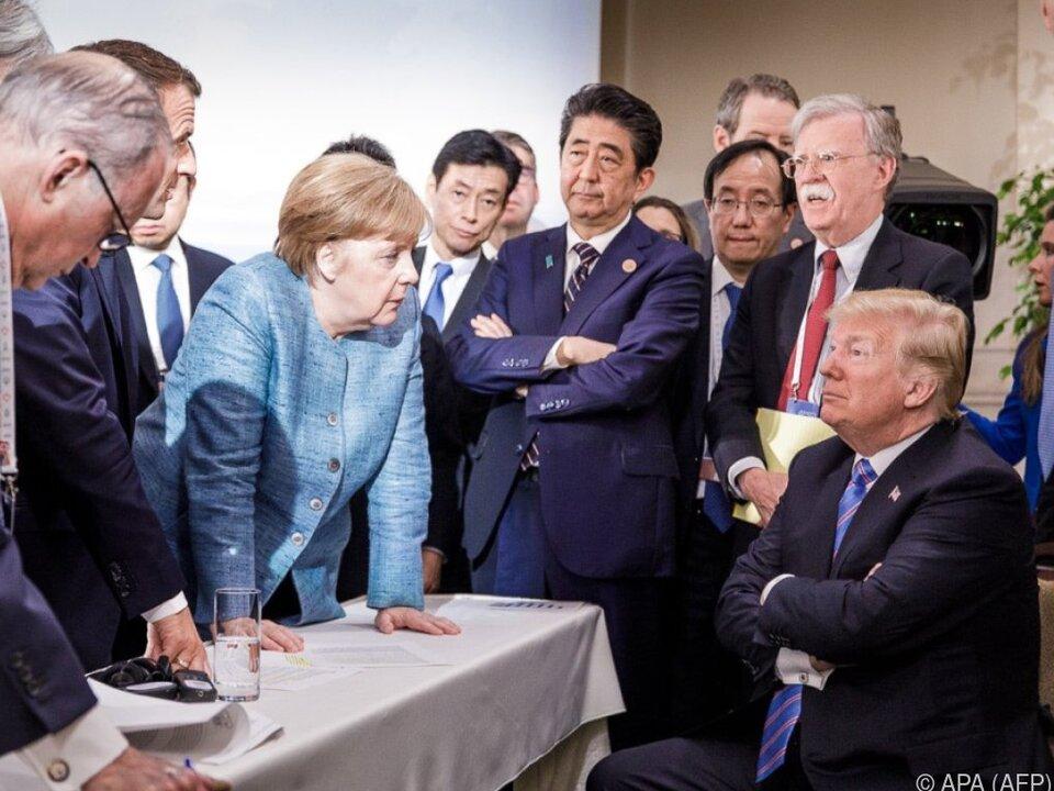 Das Foto des Gipfels: Merkel will auf Trump einwirken