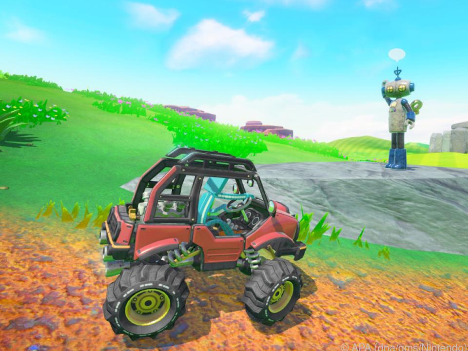 Mit dem Lenkrad kann man Autos durch die Spielwelten steuern