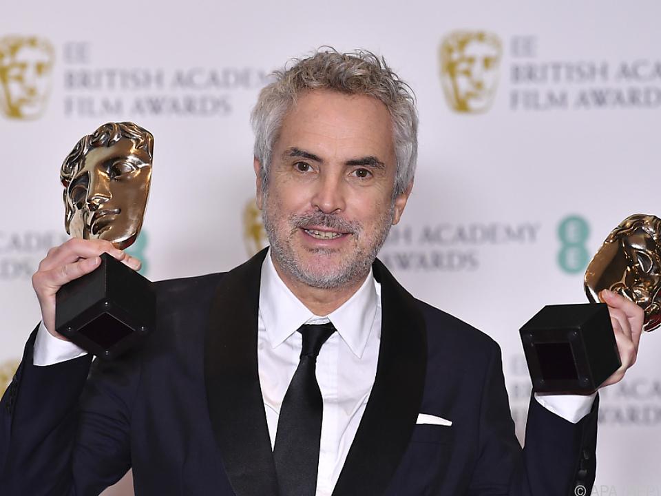 Der mexikanische Regisseur Alfonso Cuaron freut sich über seine Preise