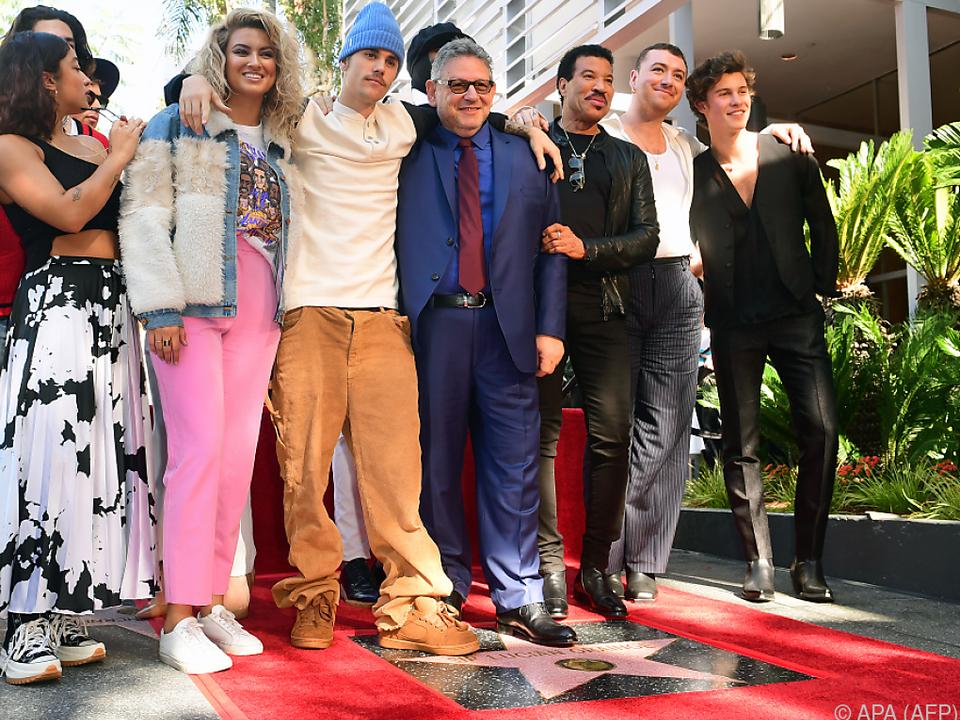 Musiker wie Justin Bieber und Lionel Richie posierten mit Grainge