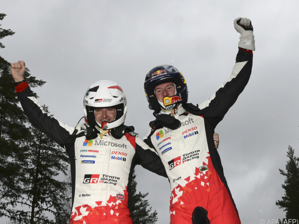 Evans (rechts) mit Co-Pilot Scott Martin