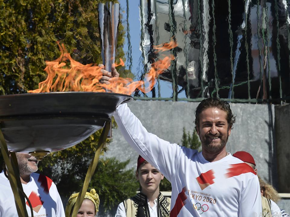 Butler war einer der Fackelträger für die Olympische Flamme