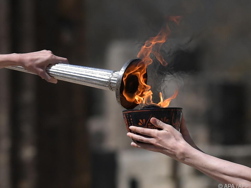 Das Olympische Feuer soll in Japan bleiben