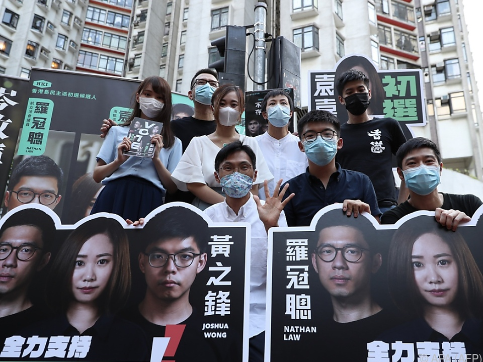 Peking-kritische Menschen setzen sich in Hongkong zur Wehr