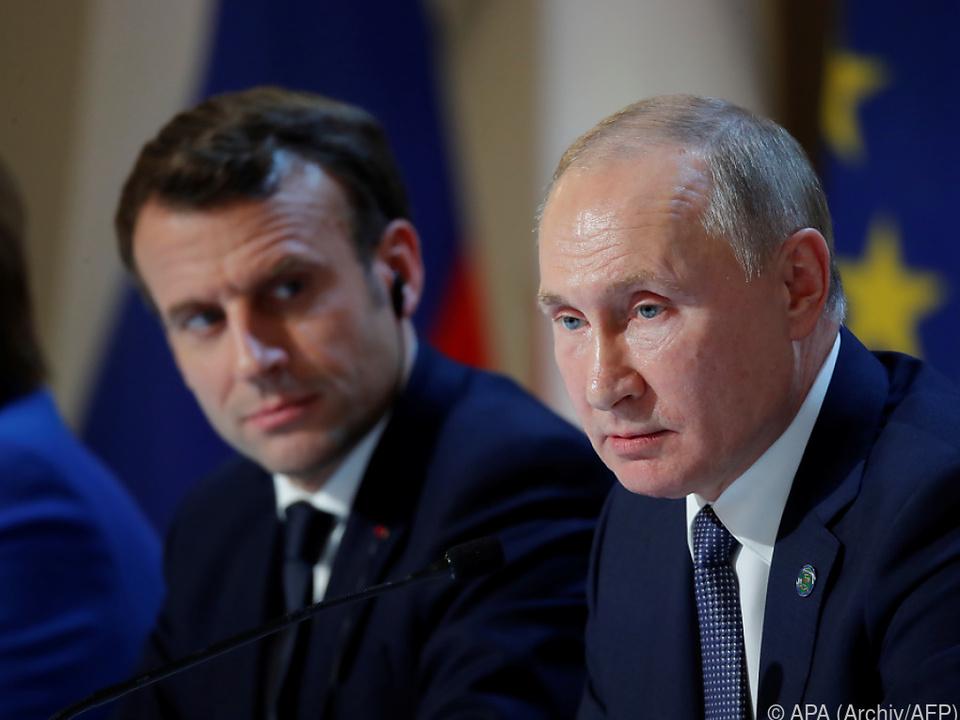 Macron und Putin wollen Bemühungen in Minsk-Gruppe verstärken