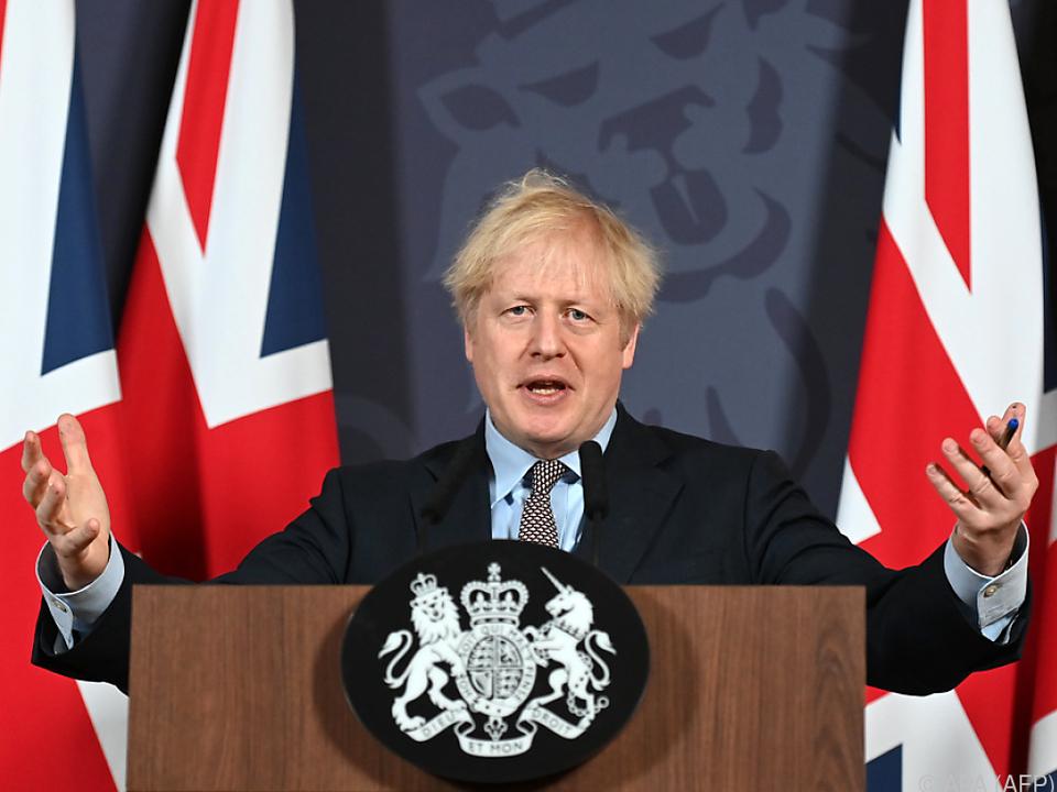 Premier Johnson in einer Pressekonferenz am Heiligen Abend