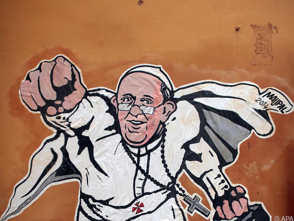 Papst Franziskus als Wandsticker an einer römischen Hauswand 2014