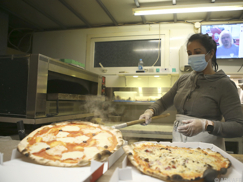 Pizza über Dienste zu liefern kann für Lokale wenig lukrativ sein