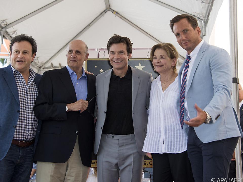 Bateman (Mitte) mit Walter und anderen im Jahr 2017