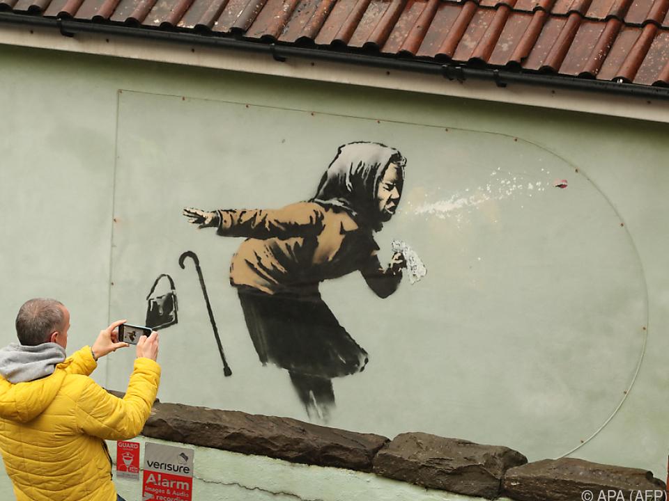 Werke von Banksy sind ein sehr beliebtes Fotomotiv