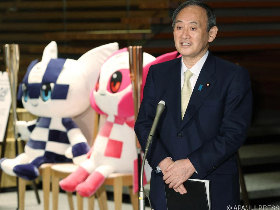Staatschef Suga hat mit Olympia alle Hände voll zu tun