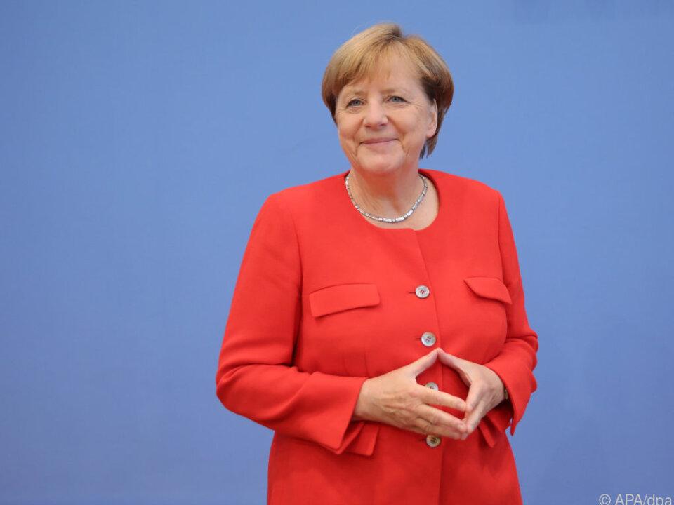 Merkel mit ihrer berühmten Raute