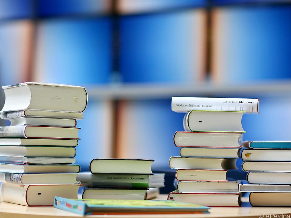 bücher bibliothek sym Buch- und Zeitungsverlage unter Druck